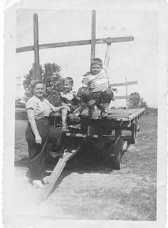 me, mom, brother Herb on hay wagon, summer 1952