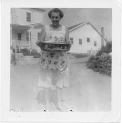waitress, Edna, bringing scraps of food for the cats, summer 1956