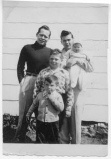 five brothers: (rear left) Howard, (rear right), Norman, (center) Herb, (front) Dennis, (far right) Bruce, in front of barn 1951