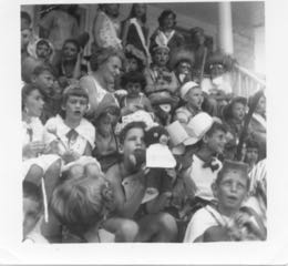 Mrs. Rosenberg sitting with children in costumes on back steps of main house, summer 1956