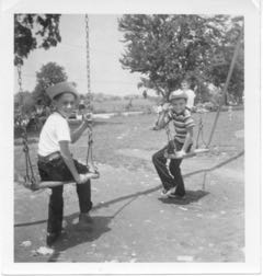 me and friend, Andy Braunstein, on swings, August 1956