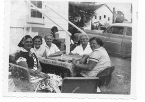 mom, aunts Mary and Natalie, cousin, Ruthie, playing mah jongg in front of 4-room bungalow, July 1959